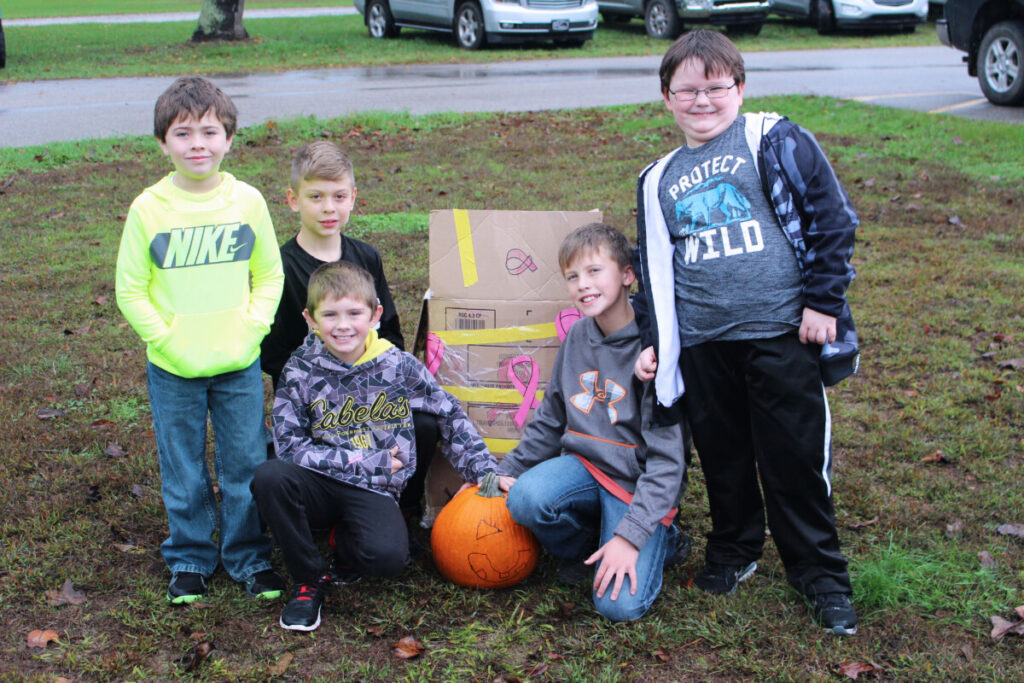 Group one poses with its unharmed pumpkin.