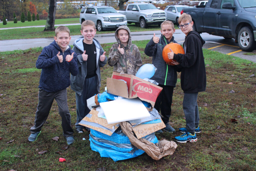 Group two poses with its unharmed pumpkin.