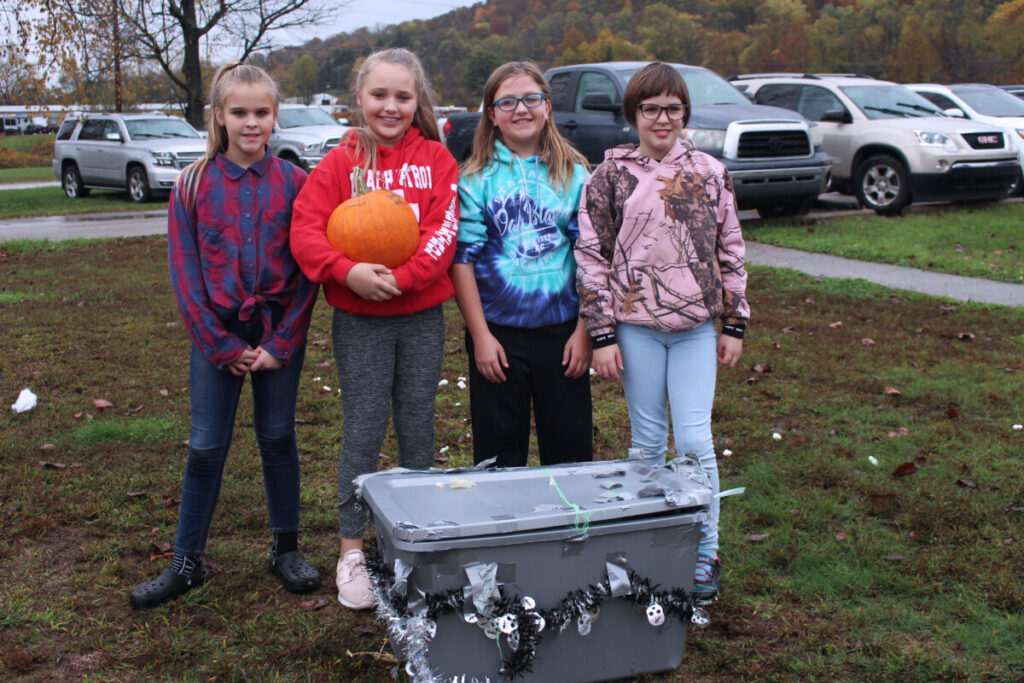 Group three poses with its unharmed pumpkin.