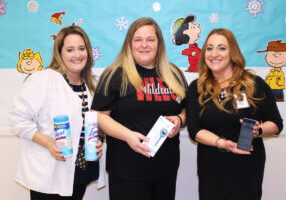 Pictured from left: Christina Robinson (WLES Nurse), Brandi Newland (parent) and Julie Sturgill (WLES Principal) show off the smart thermometers and the app being used through the Kinsa FLUency program.