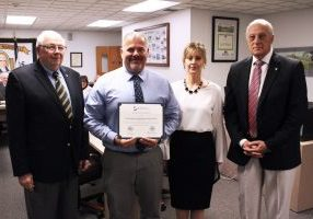 Pictured from left: WV BOE member Dr. Jim Wilson, Washington Lands Elementary Principal Mike Berner, WV Office of District and School Advancement representative Kathy Hypes and WV BOE member Bob Dunlevy.